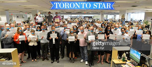 Toronto Star newsroom staff show solidarity in what has become a global call by journalists for jailed Al Jazeera colleagues in Egypt to be freed...
