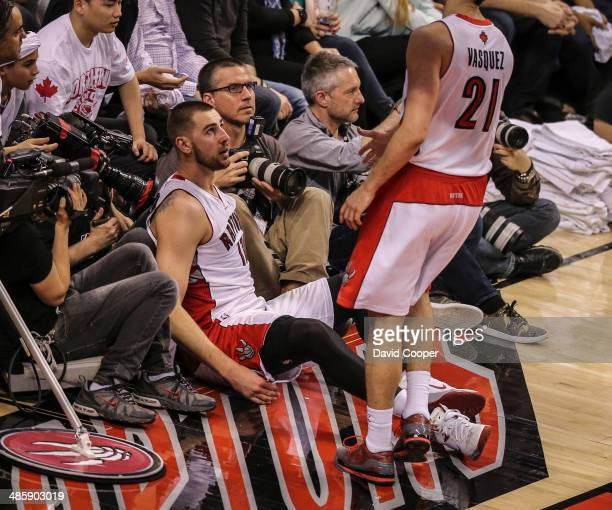 TORONTO ON APRIL 19 Toronto Star photographer Steve Russell and Canadian Press Photographer Chris Young wait for Toronto Raptors guard Greivis...