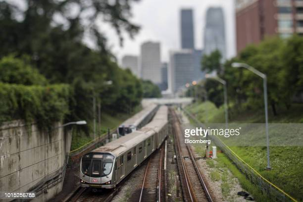 Image was created using a variable planed lens A Toronto Transit Commission commuter train travels down a track in Toronto Ontario Canada on...
