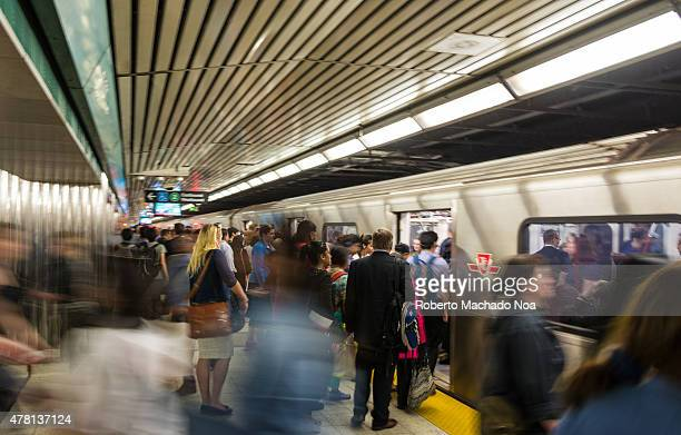 Toronto TTC transit commission subway station during rush hour busy crowded underground train station