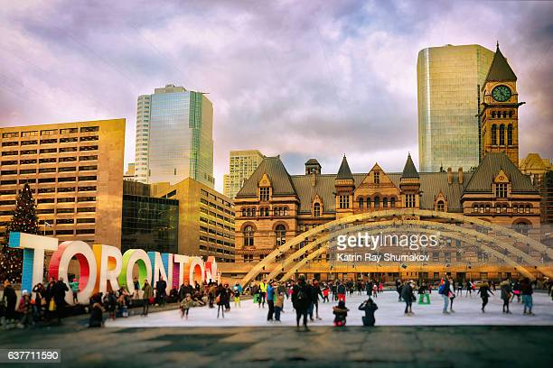 toronto winter fun on nathan phillips square - toronto stock pictures, royalty-free photos & images