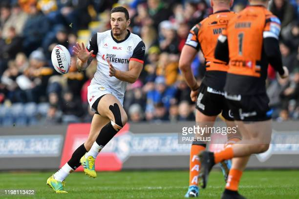 Toronto Wolfpack's New Zealand player Sonny Bill WIlliams receives the ball for the first time during the English rugby league super league match...