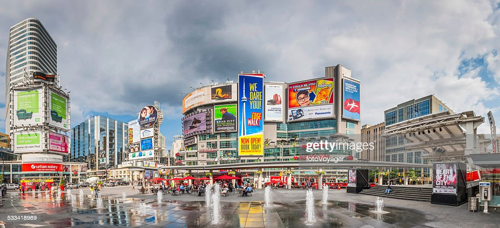 Toronto Yonge Dundas Square crowds fountains colourful billboards panorama Canada : Stock Photo