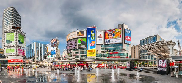 Toronto Yonge Dundas Square crowds fountains colourful billboards panorama Canada 533418989