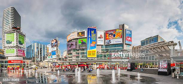 toronto yonge dundas square crowds fountains colourful billboards panorama canada - toronto stock pictures, royalty-free photos & images