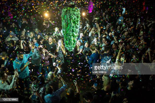 Torontonians gather at a local concert venue to watch the 'bud drop' at the stroke of midnight in celebration of the legalization of recreational...
