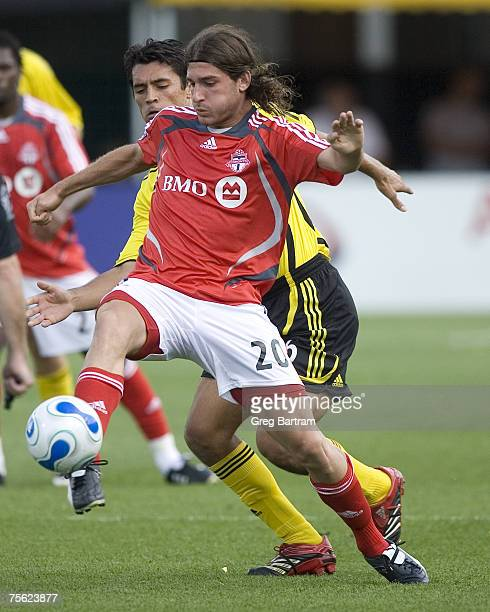 Toronto's Andrea Lombardo plays the ball in front of the Crew's Marcos Gonzalez during a game in Columbus on July 22 2007 The Crew won the game 20