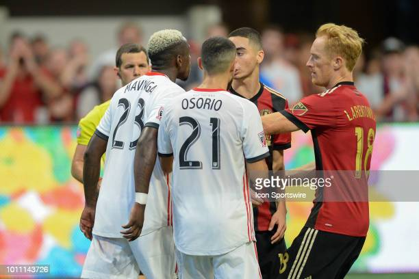 Toronto's Chris Mavinga challenges Atlanta's Miguel Almiron after the match ended resulting in a red card for Mavinga during the match between...