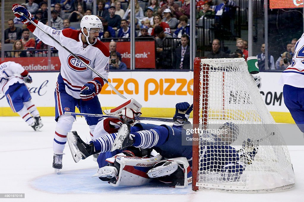 TORONTO, ON - SEPTEMBER 26 - Toronto's James van Riemsdyk took a goalie interference penalty while running into Montreal goalie Mike Condon while Mark Barberio looks on during the 3rd period of the pre-season game between the Toronto Maple Leafs and the Montreal Canadians at the Air Canada Centre on September 26, 2015. Montreal defeated Toronto 1-0.