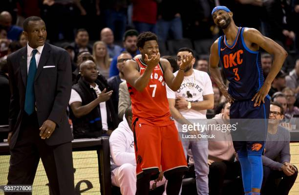 Toronto's Kyle Lowry and Oklahoma's Corey Brewer react as Toronto coach Dwayne Casey was ejected from the game late in the fourth quarter in a...