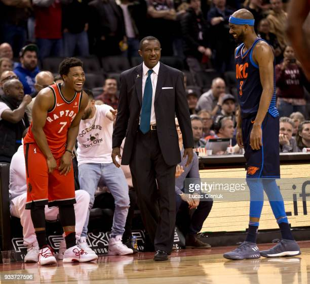 Toronto's Kyle Lowry and Oklahoma's Corey Brewer react in amazement as Toronto coach Dwayne Casey is ejected from the game late in the fourth quarter...