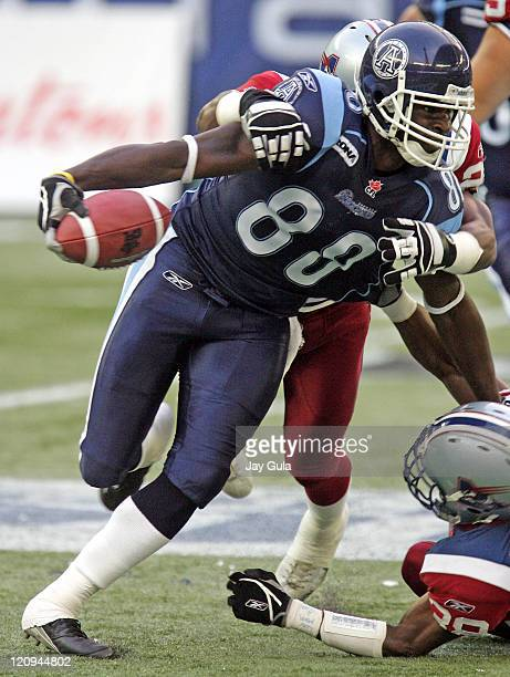 Toronto's Robert Baker fights for yardage after making a reception as the Montreal Alouettes play the Toronto Argonauts in CFL Football action at...