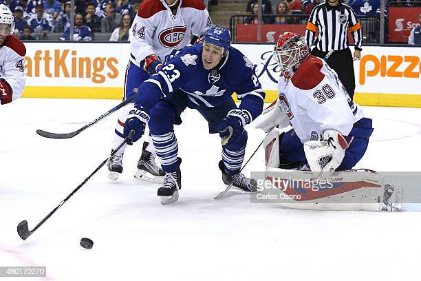 TORONTO ON SEPTEMBER 26 Toronto's Shawn Matthias tries to corral the puck and shoot on Montreal's goalie Mike Condon during the preseason game...