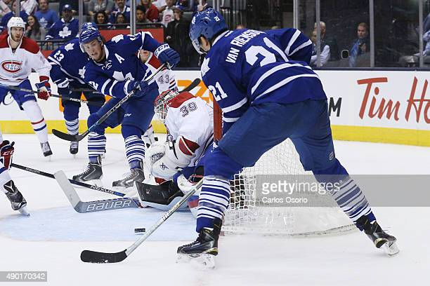 TORONTO ON SEPTEMBER 26 Toronto's Tyler Bozak passes the puck in front of Montreal's goalie Mike Condon to James van Riemsdyk during the preseason...