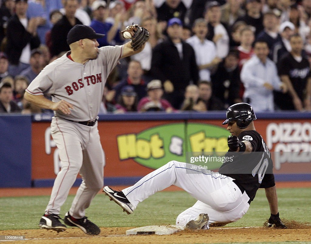 Toronto's Vernon Wells slides into third base with a 2 RBI triple ahead of the tag from Boston's Kevin Youkillis at Rogers Centre in Toronto, Canada, April 22, 2006. Toronto defeated Boston 8-1.
