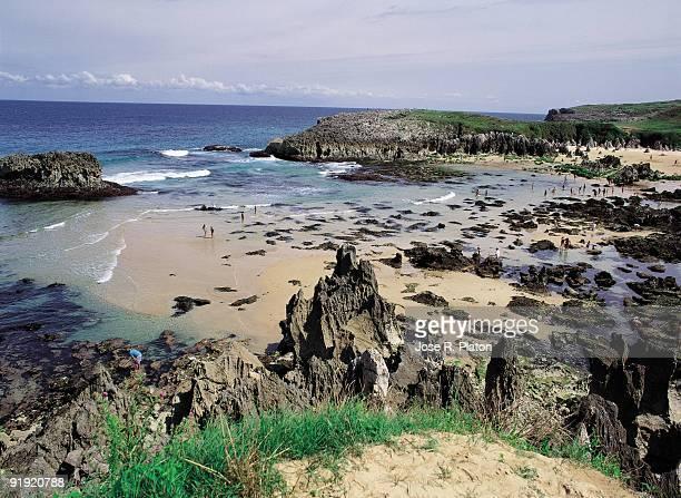 Toros beach Llanes Asturias Tourists bathing on the Toro beach Llanes village Asturias province