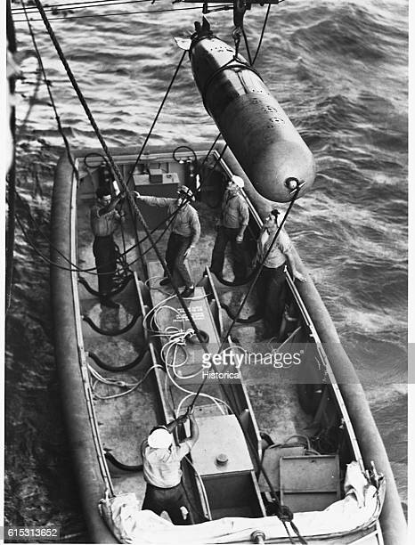 Torpedo Being Lowered into Plane Rearming Boat