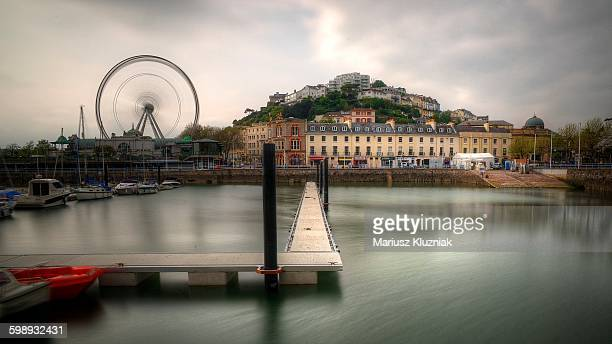 Torquay harbour pier and old town with city wheel