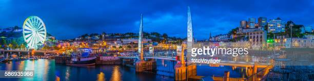 Torquay harbour waterfront hotels illuminated at dusk panorama Devon UK