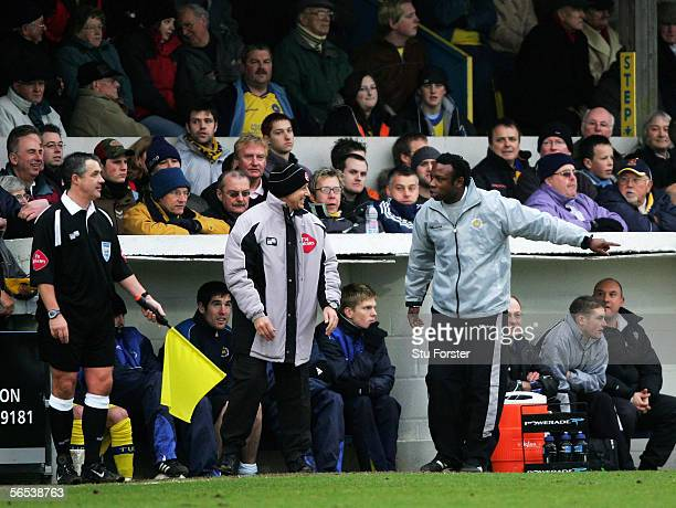 Torquay manager Leroy Rosenior makes a point to the fourth official and linesman during the FA Cup Third round game between Torquay United and...