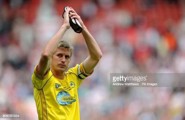 Torquay United captain Lee Mansell applauds the fans after the final whistle of the npower League Two PlayOff Final at Old Trafford Manchester