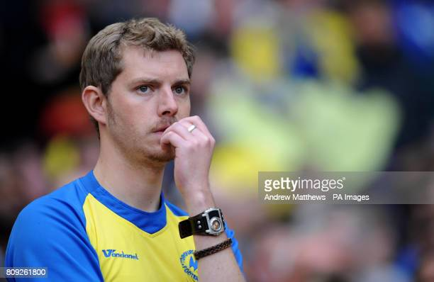A Torquay United fan looks dejected in the stands during the npower League Two PlayOff Final at Old Trafford Manchester