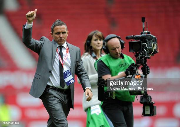 Torquay United manager Paul Buckle urges on the fans before kick off during the npower League Two PlayOff Final at Old Trafford Manchester