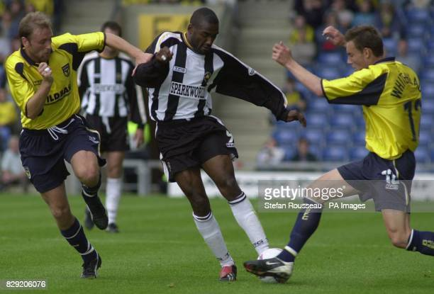 Torquay Untied's Tony Bedeau squeezes between Oxford's David Oldfield and Dean Whitehead during the Nationwide Division Three game at the Manor...