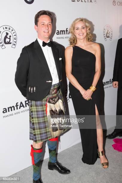 Torquhil Campbell Duke of Argyll and Sharon Stone attend the inaugural amfAR India event at the Taj Mahal Palace Mumbai on November 17 2013 in Mumbai...
