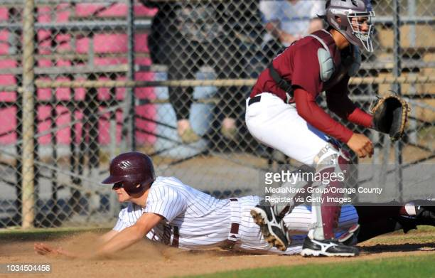 Scott Varley Torrance baseball vs Bellflower Torrance's Josh Mingura slides safely at home as Anthony Barboza waits for the ball Mingura hit a single...