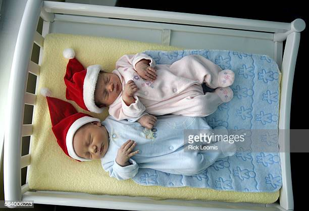 Torrance, Ca. – Twins Timothy and Kehaulani Toloski sit in the changing area on Christmas Day in their Torrance home. They are the children of Bruce...