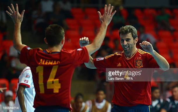 Torras of Spain celebrates with team mate Alemao during the FIFA Futsal World Cup Group B match between Spain and Panama at Indoor Stadium Huamark on...