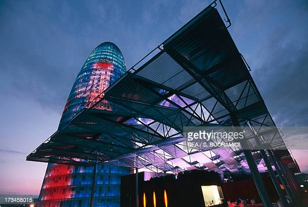 Torre Agbar illuminated built by Jean Nouvel and Fermin Vasquez and Silken Diagonal Hotel designed by Juli Capella Barcelona Catalonia Spain