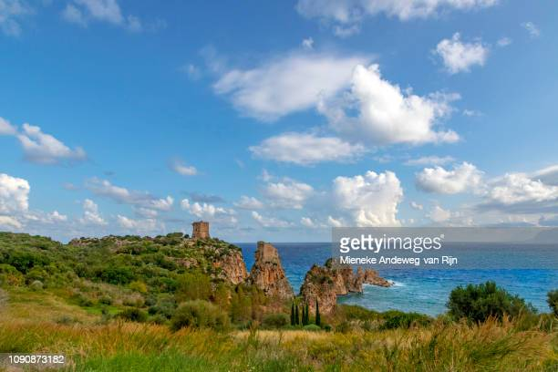 Torre Bennistra, an ancient watchtower looking out across the Gulf of Catellammare with its turquoise and blue seawater and a scenic beauty spot, Scopello, Trapani, Sicily, Italy