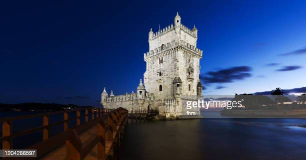torre de belém at twilight (lisbon, portugal) - local landmark stock pictures, royalty-free photos & images