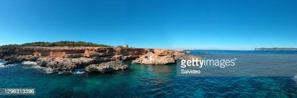 torre d'en rovira with traditional boat shelter in ibiza. - balearic islands stock pictures, royalty-free photos & images