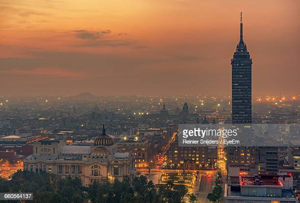 torre latinoamericana amidst buildings in city at sunset - メキシコシティ ストックフォトと画像
