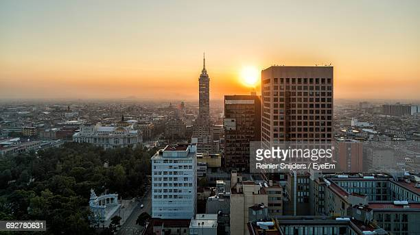 Torre Latinoamericana Amidst Cityscape Against Sky During Sunrise