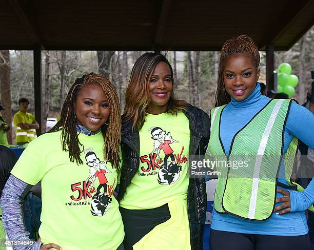 Torrei Hart Tameka Raymond and Christina Johnson attends Kile's World 5K Run/Walk at Chastain Park Amphitheater on March 29 2014 in Atlanta Georgia