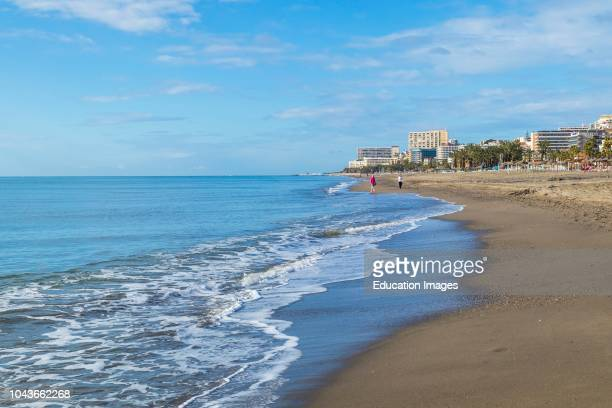 Torremolinos, Costa del Sol, Malaga Province, Andalusia, southern Spain Early morning on Playamar beach.