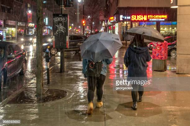 torrential rain in montreal at night - torrential rain stock pictures, royalty-free photos & images