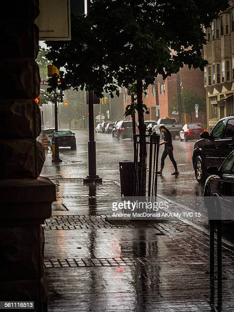 torrential rain storm in down town street - peterborough ontario stock photos and pictures