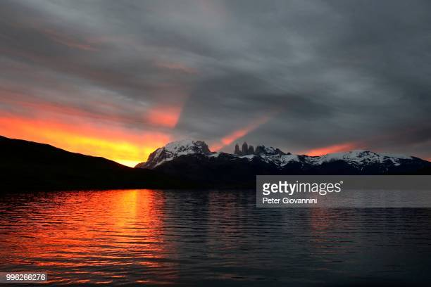 Torres del Paine at sunset with clouds, Laguna Azul, Torres del Paine National Park, Ultima Esperanza Province, Chile