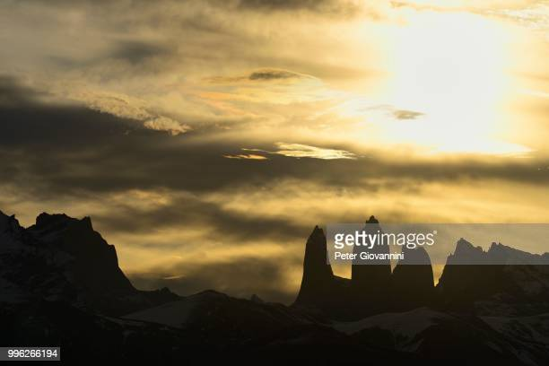 Torres del Paine at sunset with clouds, Torres del Paine National Park, Ultima Esperanza Province, Chile