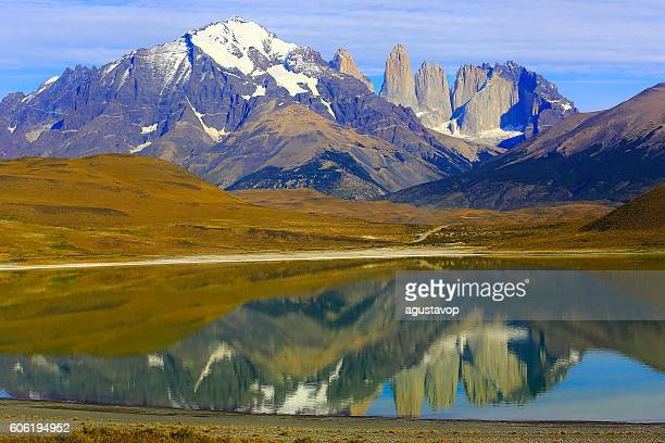 Torres Del Paine Granites over steppe, mirrored lake, Chilean Patagonia