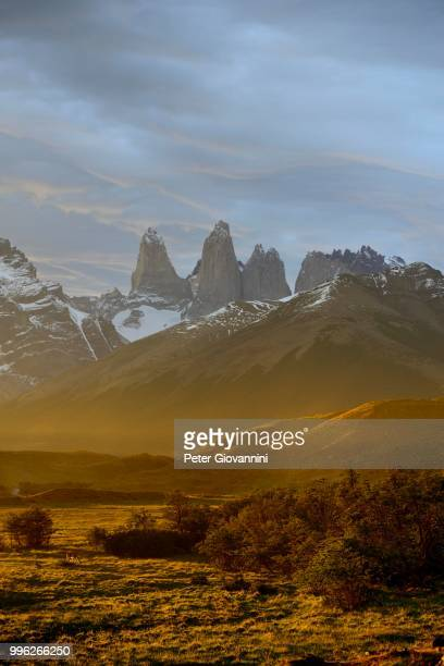 Torres del Paine massif with dust cloud at sunset, Torres del Paine National Park, Ultima Esperanza Province, Chile