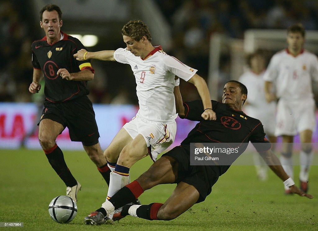 Torres of Spain battles for the ball with Vincent Kompany of Belgium during the group seven 2006 World Cup qualifying match between Spain and Belgium at El Sardinero Stadium on October 9, 2004 in Santander, Spain.