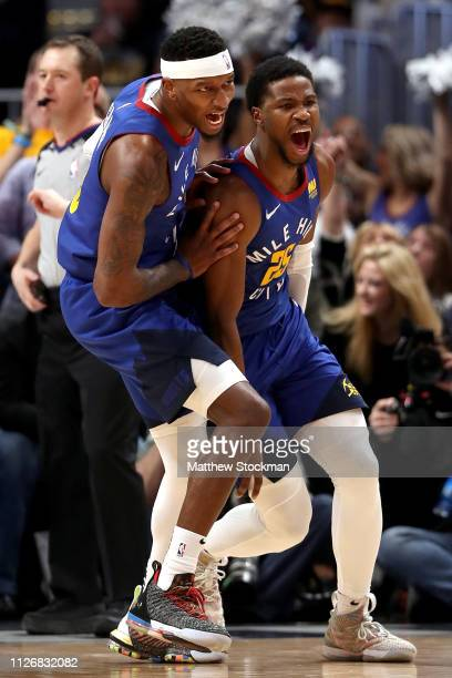Torrey Craig and Malik Beasley of the Denver Nuggets celebrate a dunk by Beasley against the Houston Rockets in the second quarter at the Pepsi...