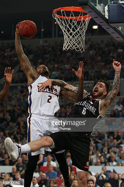 Torrey Craig of the Brisbane Bullets rebounds the ball against Nate Tomlinson of Melbourne United during the round 12 NBL match between Melbourne and...