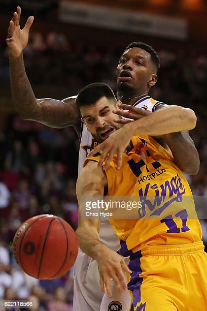 Torrey Craig of the Bullets and Kevin Lisch of the Kings compete for the ball during the round six NBL match between the Brisbane Bullets and the...